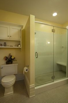 Traditional 3/4 Bathroom with Flat panel cabinets, Wall sconce, Wall mounted sink, Glass panel, frameless showerdoor, Flush
