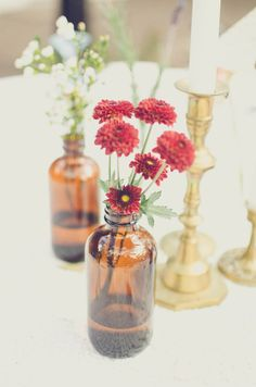 1970s Inspired Backyard Barbecue Wedding: Emily  Chris. Simple #floral ideas for great affect.