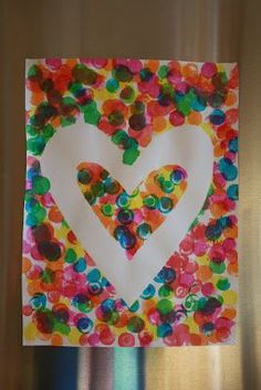 valentine craft, tape the heart shape, kids use dot painters (bingo style) markers, then peel off heart template... Could also use an eraser on the bottom of a pencil instead.