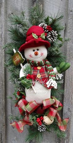 Idea/Inspiration: Crochet snowman and use Ribbon and other things as normal. Christmas Wreath Holiday Wreath Christmas Swag by NewEnglandWreath Christmas Swags, Holiday Wreaths, Christmas Snowman, Christmas Holidays, Christmas Ornaments, Snowman Wreath, Winter Wreaths, Burlap Christmas, Spring Wreaths