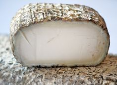 Monte Enebro- (Avila Spain)- goat's milk cheese from pasteurized milk and then inocluate the logs wih tthe mold that is used to make Roquefort. Creamy, lemony and slightly acidic (Iberian Artisanal Cheese class)