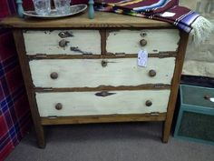 SOLD - This unique 5 door cabinet has been re-purposed. The cabinet doors are hinged and open downward. The cabinet has been painted and distressed with a natural wood top. It measures 38 inches across the front and 19 inches deep. The chest stands 44 inches tall. It can be seen in booth D 1 at Main Street Antique Mall 7260 East Main St ( E of Power Rd ) Mesa 85207  480 9241122open 7 days 10 till 530 Cash or charge 30 day layaway also available