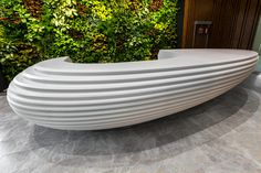 The rounded shape of the reception desk has a calming effect but, simultaneously, gives a distinct impression in the overall perception of the interior. Modern Reception Desk, Reception Desk Design, Office Reception, Futuristic Interior, Futuristic Furniture, Bureau Design, Clinic Interior Design, Wall Seating, Concrete Crafts