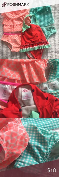 Baby Girl's Bathing Suits Set of three bathing suits in 18 month size. Each suit was worn approximately twice. The coral heart print and the mint check print are two-piece tankini style and were bought on sale from Carter's for around $15 each. The one-piece watermelon style was bought from Target for around $7. Some pilling on the seats (see third and fourth photos) but still in good condition. Bright vibrant colors! They all looked adorable on my little girl! Carter's Swim