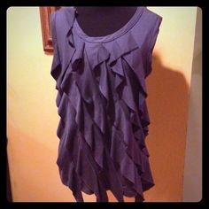 Cute ruffled top Sexy dark grey sleeveless top. This would go great with black or white skinny jeans and strappy heels. Never worn Tops