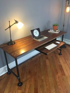 This listing is for an industrial pipe desk built with Black Walnut. This item is very customizable in terms of dimensions and additional features (see below). The pictured dimensions are: Long X…