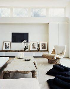 artwork under TV with low storage unit below