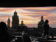 Sunset over Mexico City's old cathedral and with the Torre Latinoamericano in the background.     Fabulous