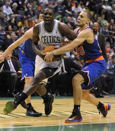 Boston Celtics' Jeff Green, left, is squeezed by New York Knicks' Mychel Thompson (20) during the second half of an NBA preseason game in Albany, N.Y. on Saturday, Oct. 20, 2012. (AP Photo/Tim Roske)