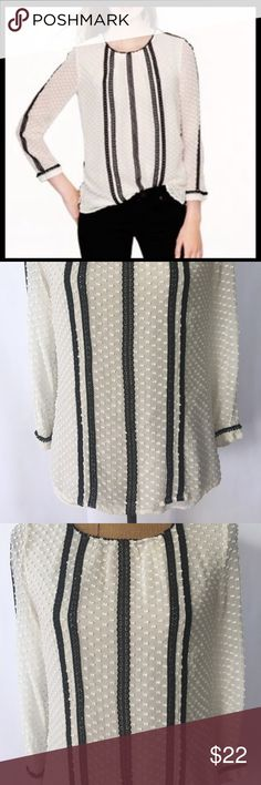 """J. Crew Ivory Silk  Lace Stripes ButtonsBlouse 2 J. Crew Women's Ivory Silk/Cotton Black Lace Stripes Back Buttons Blouse 2 Gently used pre-owned condition with no rips or stains. Comes from a smoke/pets free home. Approximate measurement's as fallow with item laying flat: Length-23"""",Arm pit to arm pit-18"""", Sleeves-19.5"""". I'm more than happy to answer any questions if more information are need it. PayPal only. Check out my other items I have for sale. J. Crew Tops Blouses"""