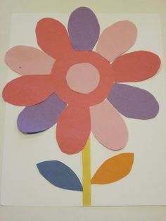 Construction paper flower with purple ovals.