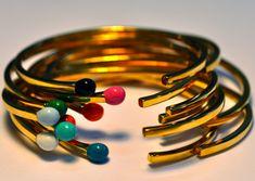Matchstick Cuffs by Nora Kogan