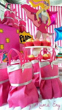 Fun favors at a Barbie superhero birthday party! See more party planning ideas at CatchMyParty.com!