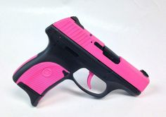 This is a Ruger LC9 9mm Handgun with a contrast pattern in Hogue pink and the frame done up for a little extra contrast! - www.tzarmory.com