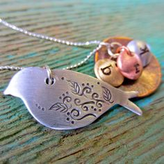 mama bird necklace.  I would like this very much please.