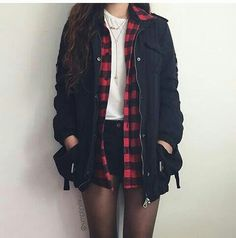 White shirt with a red plaid shirt and a black jacket and black shorts with…