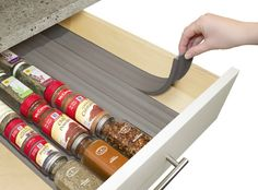 In drawer spice organizer ($14.99). Store and organize 24 full-size round or square spice bottles in a drawer with this soft foam that keeps bottles securely in place with labels facing up for quick selection. Fits standard kitchen drawers and can be easily trimmed with scissors