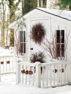 Like the railing around the front of the garden shed by - garden shed plans - Plantio Christmas Branches, Christmas Lights, Cabins And Cottages, Country Cottages, Cozy Cottage, White Cottage, Cottage Office, Cottage Style, Outdoor Christmas Decorations