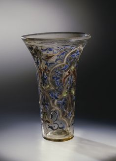 "The ""Luck of Edenhall"" is a glass beaker that was made in Syria or Egypt in the middle of the century, elegantly decorated with arabesques in blue, green, red and white enamel with gilding. (Victoria and Albert Museum, London) Drinking Glass, Medieval Art, Victoria And Albert Museum, 14th Century, Western Art, Islamic Art, Middle Ages, Colored Glass, Calla Lilies"