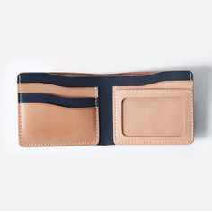 This is a beautiful made simple and stylish handcrafted mans wallet. The wallet is made from vegetable tanned leather. This wallet is a combination color between indigo blue ( We have custom options, over 10 colors of leather ) and natural tan vegetable tanned leather wallet which is completely made by hand. There are 1 ID window pockets, 4 pockets for cards and 1 large bill compartments. This item is a great gift for giving to your best friend or your relative in any occasion~ Measurements…