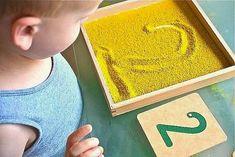 Inexpensive and DIY Sandpaper Numerals Plus Alternatives Sandpaper Numerals with Sand Tray (Photo from How We Montessori) Montessori Preschool, Preschool Learning, Preschool Activities, Kids Learning, Montessori Room, Preschool Colors, Montessori Elementary, Maria Montessori, Learning Games