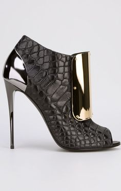 Giuseppe Zanotti - I like the look of this shoe, but I could never wear it.