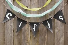Our vinyl pennants are easily customized to your wedding or event. An alternative to hand-lettering is cutting opaque contact paper with a craft knife!