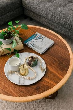 A Sneak Peek Of Our Revamped Living Room / Wood Coffee Table Rattan Coffee Table, Round Coffee Table, Home And Living, Living Room, Living Spaces, Article Sofa, Bring Up, Beaded Garland, New Print