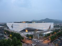 Tencent Beijing Headquarters is a glass campus designed by OMA.