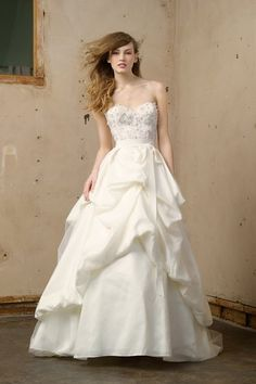 Watters, Wtoo Brides. Style: Poppy. Ivory silky taffeta bustled skirt with tulle overlay. Chapel train.