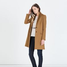 ZARA Wool Camel Coat • From the F/W 2014 collection • 78% Wool / 28% Polyamide outer • 100% Acetate lining • Camel color • Smooth lining • 2 decorative pockets on the outside; not functional but are still seamed; You can remove the seams if you would like • 2 decorative inner pockets; I opened the seams, thinking they were real • Size S • No pilling • Will steam before shipping to remove wrinkles • In great condition • Only worn a few times, only selling because I'm looking for something a…