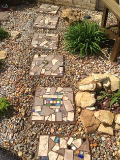 Old pavers converted to mosaic stepping stones.