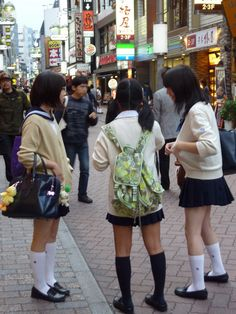 Some school girls on the streets if Tokyo