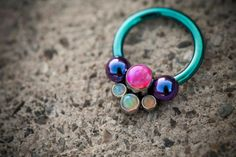 """These beautiful circular barbells are made from internally threaded F-136 titanium. They feature a removable gem cluster and have been anodized to match! These look amazing in septum, tragus and conch piercings! 16g 5/16"""" Circular Barbell. Other sizes available at [Born This Way Body Arts - Knoxville, TN]"""