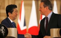 Shinzo Abe (left), prime minister of Japan, visits David Cameron at 10 Downing Street