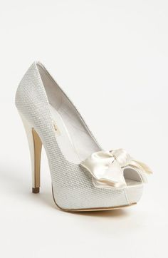 Free shipping and returns on Menbur Bow Pump at Nordstrom.com. A peep-toe pump fit for a fairy tale is lavished with starlight sparkle and a lush satin bow.