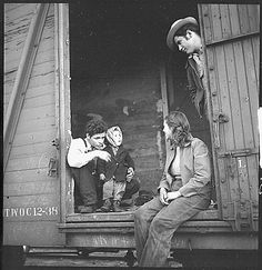 A family of Mexican agricultural workers heading for Utah. The mother is twenty, the father twenty-one, the child three, and the other man is the brother of the father. They had slept out overnight in the grass without bedclothing; the childs overalls are wet with dew and he wears galoshes. A veteran migrant, he has been traveling by freight ever since he was four months old. His family follow a circuit of beets and cotton through Utah, Texas, and California. 1940