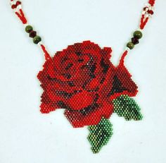 The rose is 3 long and 2 1/2 wide. On the necklace part I have used red and white crystals, along with serpintene and silver beads. It has a silver togle clasp, with the overall length of 18 1/2 long.    I use delica beads and fireline.    You can find matching earrings in my listing.