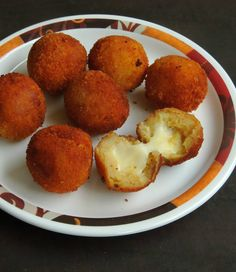 Try our creamy simple hazzle free snack - The Mozzarella Stuffed Potato Balls that is crispy and just melt in mouth. They make a great party appetizer along with a good cocktail. Give it a try and tell us how you liked it and send us a picture too. Recipe by Priya. -->http://ift.tt/1RccYC6 #Vegetarian #Recipes
