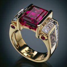 RANDY POLK DESIGNS:  A TIMELESS CLASSIC Large 7-8 ct emerald-cut Rubellite Tourmaline, 4 tube-set Ruby cabochons, inlaid petrified palm, app.26 Diamonds channel-set and pavé CLAS-007♥•♥•♥WOW!