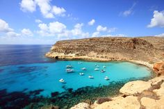 Lampedusa Rich in coves and grottos, Lampedusa is a nature-lover's delight. Visitors to this Pelagian Island, which neighbors the African coast, often spot dolphins and sea turtles.