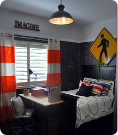 love the construction theme. The curtains are hung on pipe instead of a curtain rod.