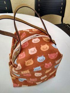 Bolsa com alça de couro
