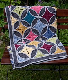 """""""Cathedral window"""" is a popular motif pattern for quilts. It take their inspiration from the beautiful shapes and patterns of the stained glass windows found in churches and cathedrals around the world. I have convert this sewing pattern into a crochet pattern."""