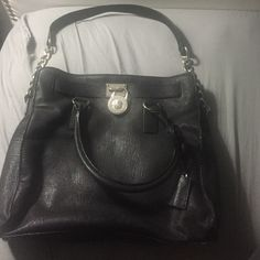 *AUTHENTIC* Black Michael Kors Hamilton Bag Might as well be brand new! Barley used. This chic black purse with silver hardware will match any outfit! Michael Kors Bags Satchels