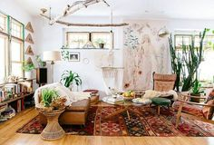 You'll Never Think of Bohemian Style the Same Way Again One Kings Lane -- Justina Blakeney's The New Bohemians is the ultimate bohemian bible for lovers of the rustic, earthy, colorful style, and this gorgeous living room filled with leather, vintage kilim rugs, indoor cactus and wood proves it!