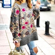 We love this jumper by Zara The oversized floral embroidered sweater is a MUST HAVE for this fall.