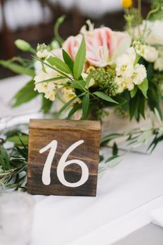 Wooden wedding table numbers: http://www.stylemepretty.com/california-weddings/winters-california/2016/08/17/this-sunset-wedding-is-take-your-breath-away-beautiful/ Photography: Retrospect Images - http://weddings.retrospectimages.com/home/