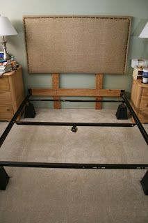 good photo of attaching diy headboard to metal frame vs. the wall.
