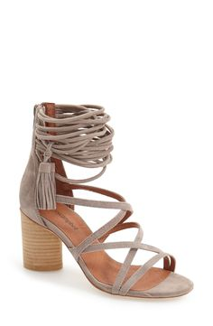 New favorite? These Jeffrey Campbell sandals have a rounded block heel, suede straps, and a tassel-embellished ankle detail.